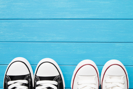 pairs: Two pairs of canvas shoes on a blue wooden