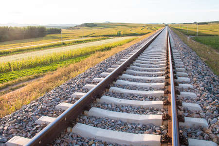 complicated journey: Railroad tracks at sunset