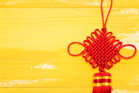 Chinese knot in yellow wood