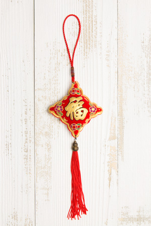 Chinese knot in white wood Stock Photo