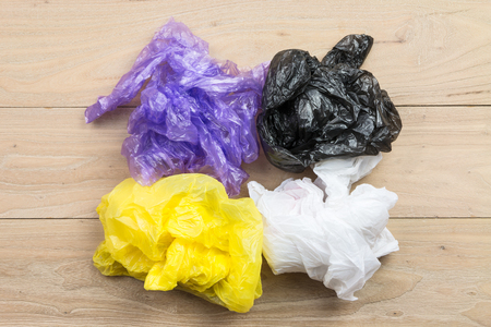 plastic bags: Plastic bags on the wood Stock Photo