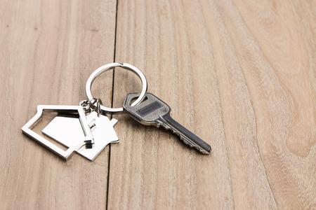 House-shaped key  on the wood background
