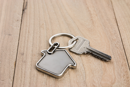 House-shaped key  on the wood background