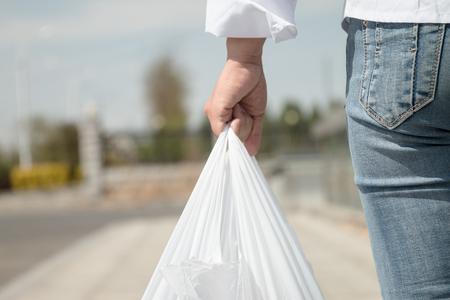 Woman holding a plastic bag Standard-Bild