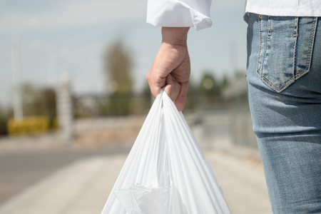 Woman holding a plastic bag Stock Photo
