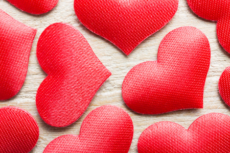 Heart-shaped objects on a wooden background