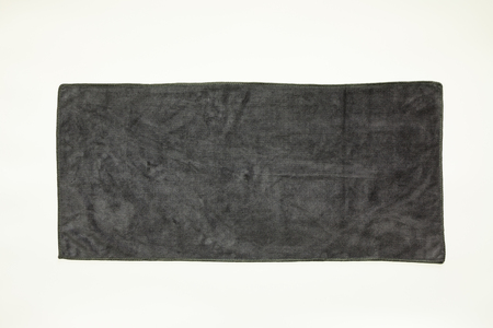 Black towel on a gray background