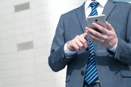 Asian man using smart phone Stock Photo