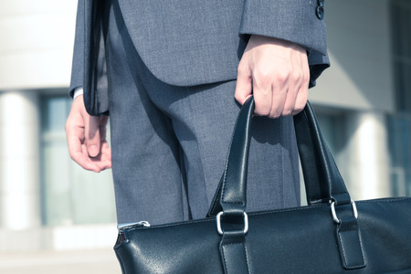Asian businessman holding a briefcase Stock Photo