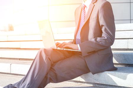 Asian man using laptop