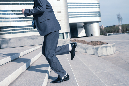 Asian businessman up the stairs Stock Photo