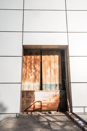 Rusty door and modern building Stock Photo