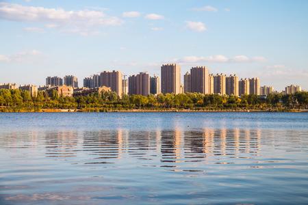 Chinese urban architecture and lake Stock Photo
