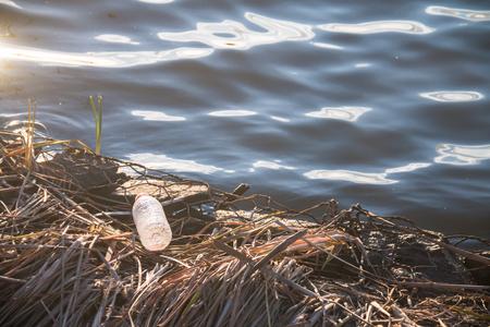 Abandoned plastic bottle at the lake Stock Photo