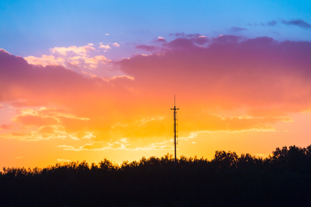 Silhouette of tower and tree under sunset