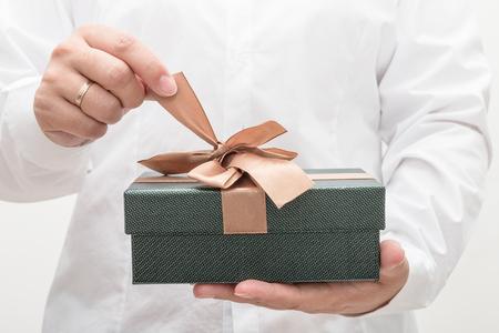 Woman giving christmas present Stock Photo