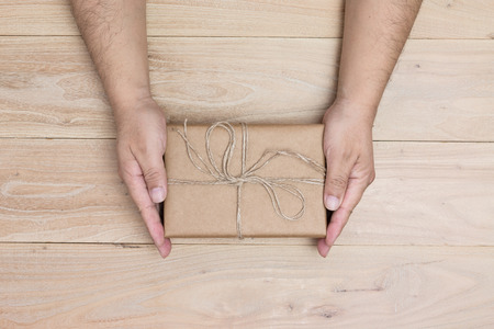 Male hands holding gift box