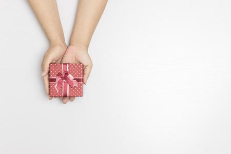 Female hands holding gift box Stock Photo