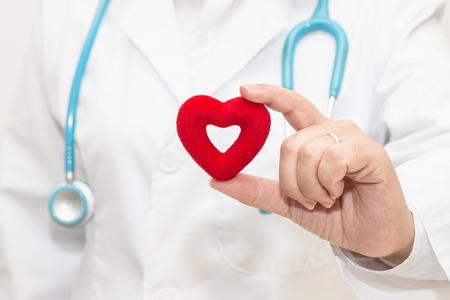Doctors hand holding a heart shape