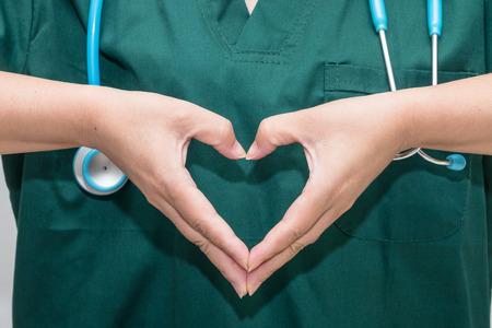 Doctors hands forming a heart shape