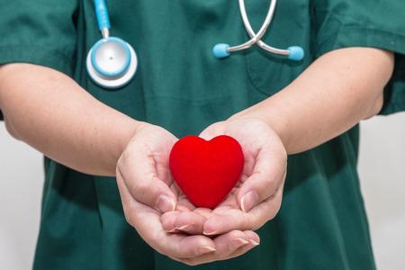 Doctors hands holding a heart shape
