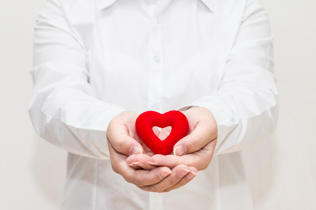 Womans hands holding a heart shape Stock Photo