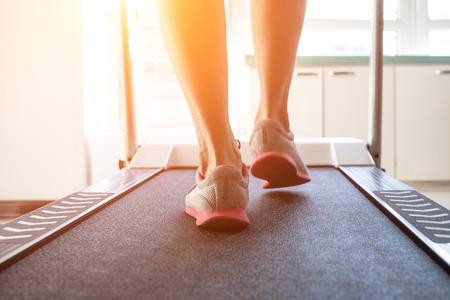 Woman doing fitness on a treadmill Stock Photo - 115866268