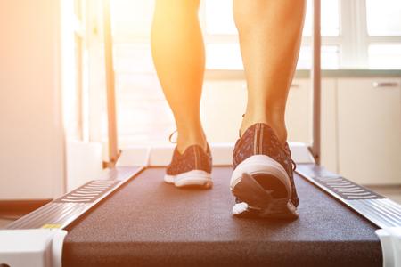 Man doing fitness on a treadmill Stock Photo - 115866295