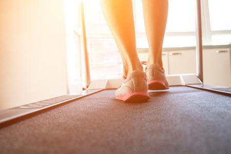 Woman doing fitness on a treadmill Stock Photo - 115866325