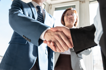 Business people shaking hands Stock Photo - 117097869