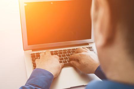 Man using laptop Stock Photo - 118478195