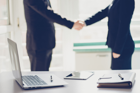 Business people shaking hands Stock Photo - 118965299