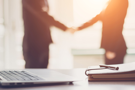 Business people shaking hands Stock Photo - 118965305