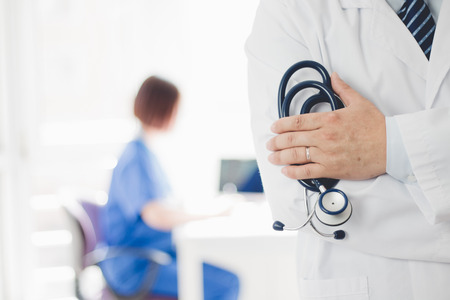 Doctor at the office Stock Photo - 119186336