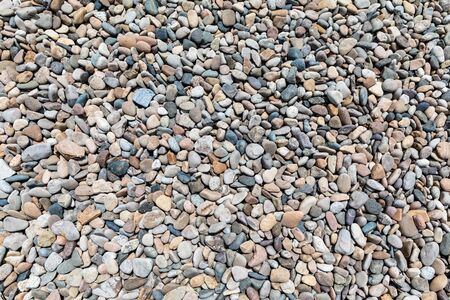 Closeup beach cobblestone texture background