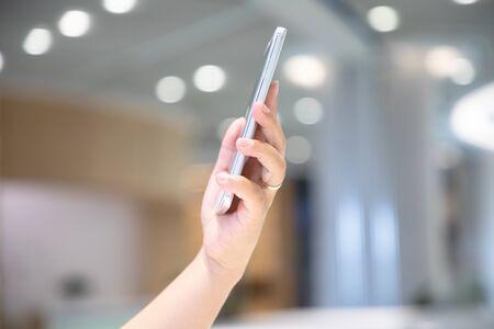 Asian woman using smartphone Imagens