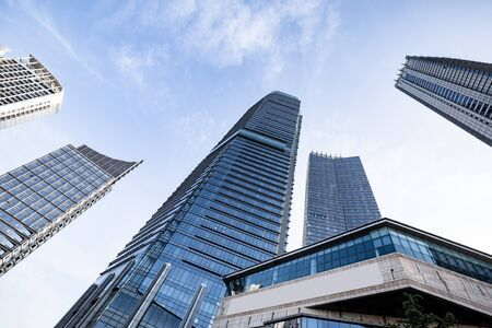Low angle shot of modern glass building Stock Photo - 124687471