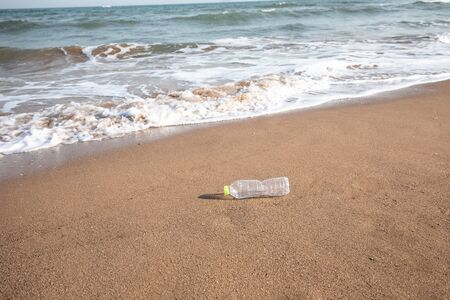 Abandoned plastic bottle on the beach