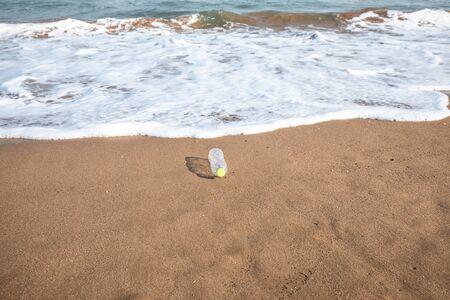 Abandoned plastic bottle on the beach