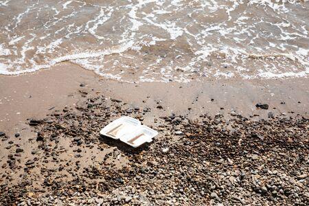 Empty fast food box at the beach 写真素材