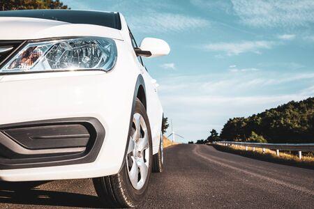 Closeup white car on the road