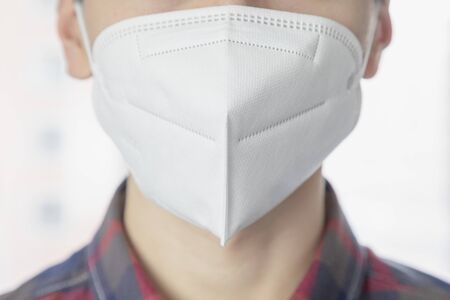 Asian young man wearing protective mask Stock Photo