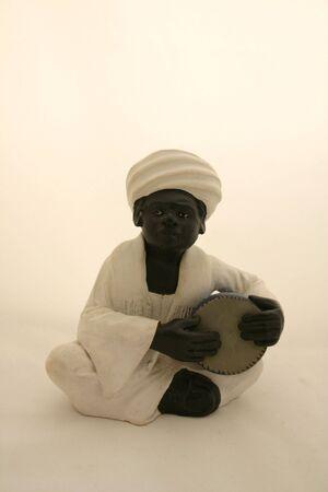 figurative: Clay Figurative Nubian Drummer Stock Photo