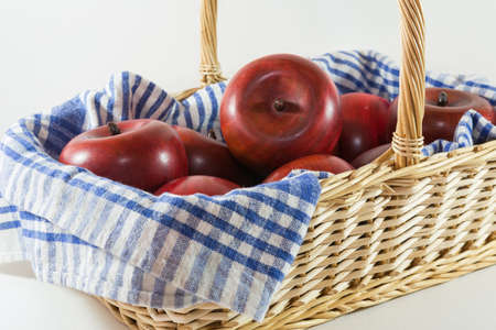 Wicker Basket with wooden apples - still life