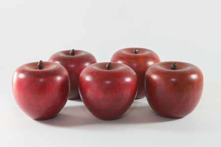 A display of decorative wooden apples Stock Photo