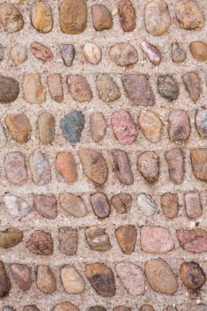 man made object: Stone Wall.  Interesting symmetrical masonry using similar sized stones set into the mortar.