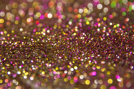 tinsel: Colorful tinsel sprinkled on the surface the table