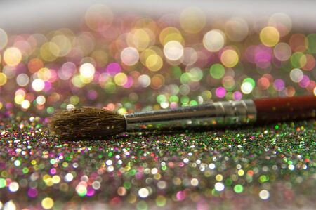 tinsel: Brush and festive multi-colored tinsel. Preparing for the new year.