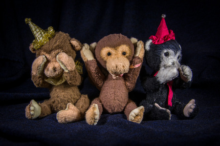 Three monkeys in clown hats, depict: do not see, do not hear, will not say