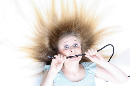 panicked: Girl under electricity Stock Photo